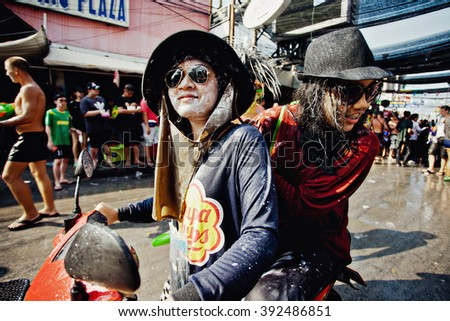 KO SAMUI, THAILAND - APRIL 13: Unidentified thai people on a bike on Songkran Festival (Thai New Year) on April 13, 2014 in Chaweng Main Road, Ko Samui island, Thailand.