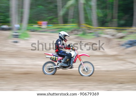 "KO SAMUI, THAILAND - DECEMBER 4: Panning view of unidentified rider during the ""Samui cyclecross racing 2011"" at Ko Samui City on December 4, 2011 in Samui Island, Thailand."