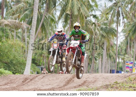"KO SAMUI, THAILAND - DECEMBER 4: Stop action of unidentified rider during the ""Samui cyclecross racing 2011"" at Ko Samui City on December 4, 2011 in Samui Island, Thailand"