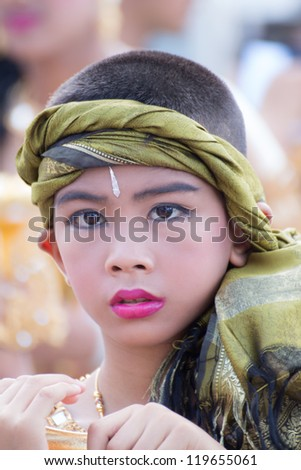 "KO SAMUI, THAILAND - NOVEMBER 7: Unidentified kid participates in ""Ngan Chak Pra"", a traditional buddhist festival on November 7, 2012 in Koh samui,Suratthani, Thailand."