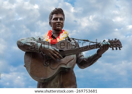 KOBE, JAPAN - OCTOBER 26: Elvis Statue in Kobe, Japan on October 26, 2014. The statue had been in Harajuku, Tokyo since 1987 and it was moved to Harborland, Kobe in 2009 - stock photo