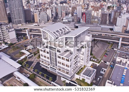 KOBE, JAPAN - OCTOBER 22, 2015: The white Notre Dame building in downtown Kobe is on the leading edge of modern architectural design.
