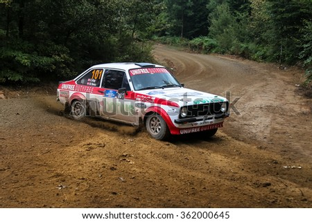 KOCAELI, TURKEY - AUGUST 23, 2015: Engin Kap with Ford Escort MK2 of Bonus Unifree Parkur Racing Team in Kocaeli Rally 2015
