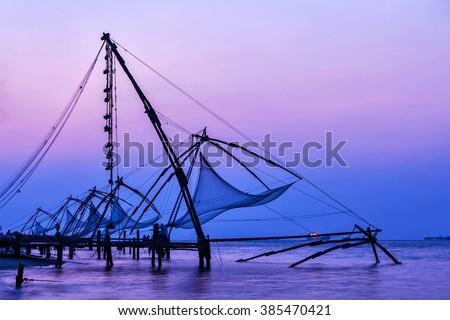 Kochi chinese fishnets on sunset. Fort Kochin, Kochi, Kerala, India - stock photo