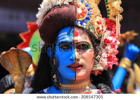 KOCHI, INDIA - AUG 19: Unidentified people dressed up as mythological characters  participate in a cultural procession as part of Onam celebration held on August 19, 2015 in Kochi, Kerala, India. - stock photo