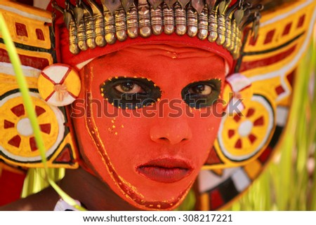 KOCHI, INDIA - AUG 19: Unidentified people in different costumes and art forms participate in a cultural procession as part of Onam celebration held on August 19, 2015 at Kochi, Kerala, India. - stock photo
