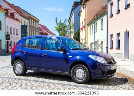 KOENIGSBRUECK, GERMANY - JULY 20, 2014: Motor car Dacia Sandero at the town street. - stock photo