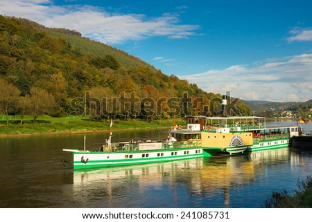Koenigstain, GERMANY - OCTOBER 15, 2014 Historic Paddle Steamer - The historic paddle steamer KURORT RATHEN departs from the landing stage in Koenigstain, Saxony, Germany - stock photo