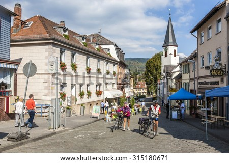 KOENIGSTEIN, GERMANY - SEP 27, 2009: people enjoy a bicycle tour in the beautiful historic town of Koenigstein, Germany. The taunus area is famous for its bicycle routes. - stock photo