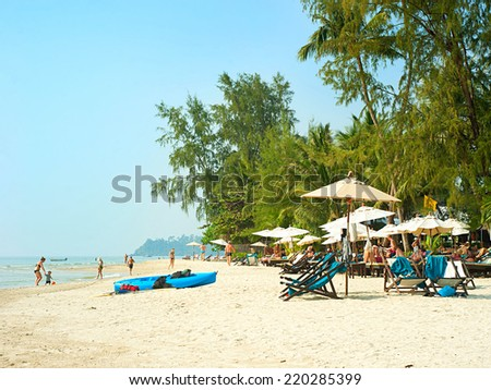 KOH CHANG ISLAND, THAILAND - FEB 02, 2013: People on the beach in Koh Chang island, Thailand. Almost 20 million tourists visited Thailand in 2013.