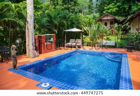 KOH CHANG, THAILAND - 2 APRIL, 2015: Hotel Saint Tropez. Swimming pool in a tropical garden - stock photo