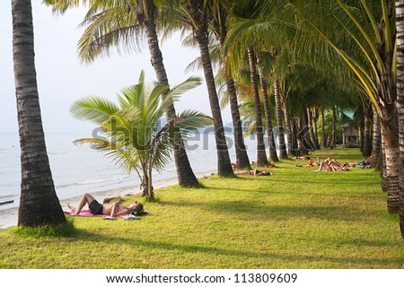 KOH CHANG, THAILAND - MARCH 12: Tourists relaxing on the beach on Koh Chang island on March 12, 2012. Almost 20 million tourists visited Thailand in 2011.
