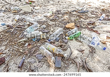 KOH DONG, THAILAND - JANUARY 11, 2015: Garbage left by tourist visiting island with organized tours from Lipe Island. - stock photo