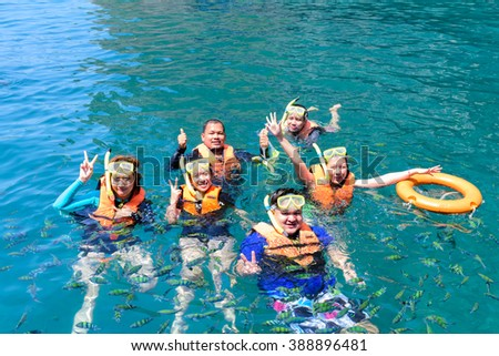Koh Ngai,  THAILAND February 19,2016: Tourists enjoy the coral  the beautiful and fish in Koh Ngai surrounded by the natural beauty of the islands in Trang province, Thailand