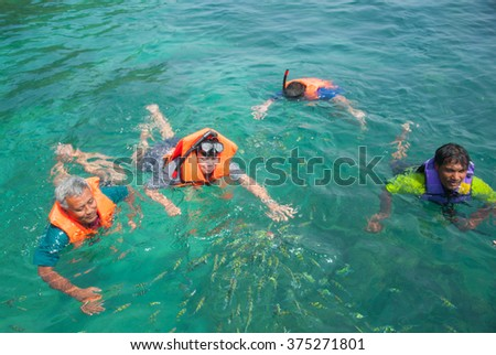 Koh Ngai, Thailand March 19, 2015: Tourists enjoy the beach and the beautiful and wide and Koh Ngai surrounded by the natural beauty of the islands in Trang province, Thailand