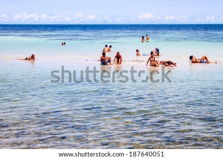 KOH PHANGAN, THAILAND - SEPTEMBER 1: People in a water at Haad Yao beach on Koh Phangan, Thailand on September 1, 2013. Haad Yao is one of the most beautiful beaches on Ko Pha Ngan. - stock photo
