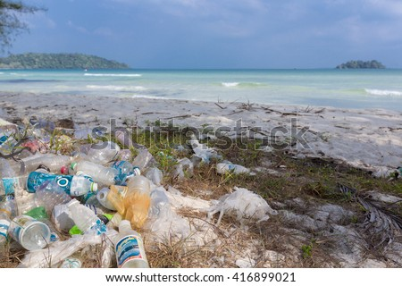 KOH RONG, CAMBODIA - JANUARY 24: Garbage and plastic bottles on a beach left by tourist at, Rong Island near Sihanoukville. Environmental pollution concept picture, Cambodia. South East Asia 2016 - stock photo