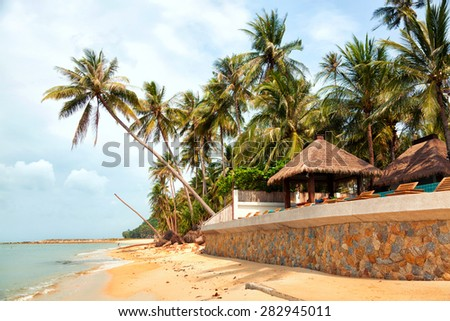 Koh Samui beach with palm trees and white sand
