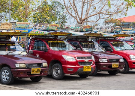 KOH SAMUI, THAILAND - APRIL 18, 2016 : Songthaew pick-up truck at Nathon pier in Koh Samui. Songthaews are used as public share taxis in Thailand with set routes. - stock photo