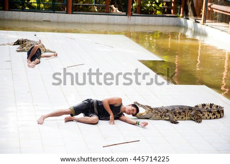 KOH SAMUI, THAILAND - December 17: Crocodile wrestler performing a show and put the head in my mouth reptiles, The Day Of St. Lazarus in December 17, 2012 - stock photo