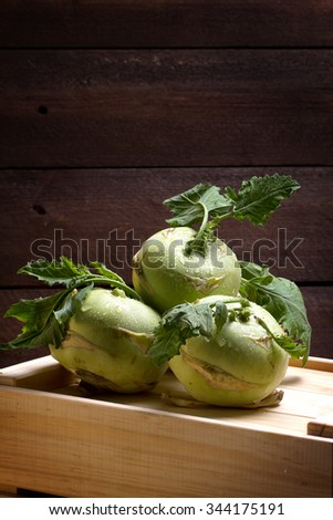 Kohlrabi cabbage on a wooden box