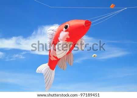 Koi fish kite on blue sky stock photo for Koi fish kite