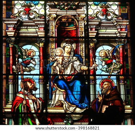 KOJETIN,CZECH REPUBLIC - March 26: Virgin Mary with Jesus, Saint Methodius (left) and Saint Cyril (right) - stained glass in Church of the Assumption in town Kojetin,Czech republic, on March 26, 2016. - stock photo