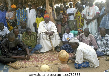 KOKEMNOURE, BURKINA FASO - FEBRUARY 24: Establishment of the new chief of village of Kokemnoure. Andre Silga the new chief will hear the history of his line of chief by the griots, february 24, 2007 - stock photo