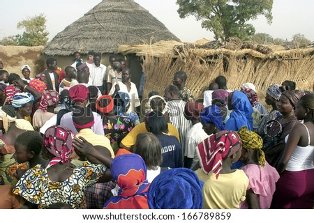 KOKEMNOURE, BURKINA FASO - FEBRUARY 24: Establishment of the new chief of village of Kokemnoure. The villagers expect the beginning of the ceremony, february 24, 2007 - stock photo