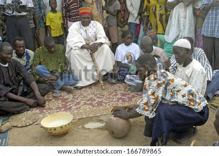 KOKEMNOURE, BURKINA FASO - FEBRUARY 24: Establishment of the new chief of village of Kokemnoure. Andre Silga the new chief of village wood the dolo, the traditional beer, february 24, 2007 - stock photo