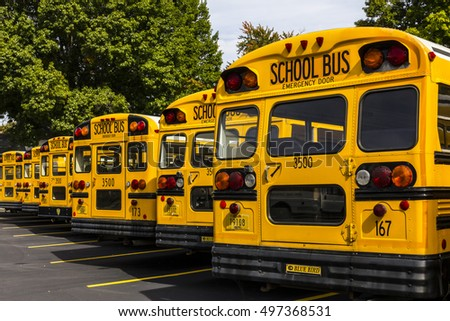 Kokomo - Circa October 2016: Yellow School Buses in a District Lot Waiting to Depart for Students VI