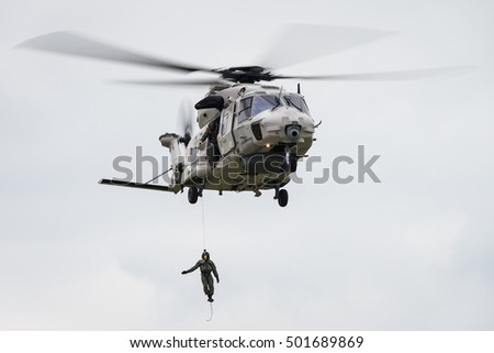 KOKSIJDE, BELGIUM - OCTOBER 12: Demonstration of a Belgian Air Force NH90 search and rescue helicopter during the International SAR Meet in Koksijde, Belgium on October 12, 2016.
