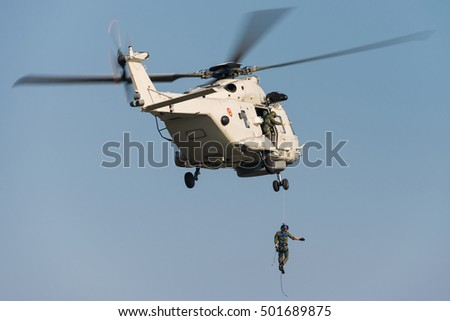 KOKSIJDE, BELGIUM - OCTOBER 11: Demonstration of a Belgian Air Force NH90 search and rescue helicopter during the International SAR Meet in Koksijde, Belgium on October 11, 2016.