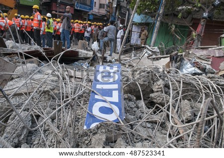 "KOLKATA - APRIL 1: A ""police"" sign lying on the debris during the rescue effort after an under construction flyover collapsed killing 27 people on April 1, 2016 in Kolkata, India."