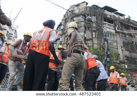 KOLKATA - APRIL 1: Police and rescue workers helping each other during the rescue effort after an under construction flyover collapsed killing 27 people on April 1, 2016 in Kolkata, India.