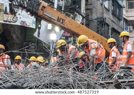 KOLKATA - APRIL 1: Rescuers cleaning up the site during the rescue effort after an under construction flyover collapsed killing 27 people on April 1, 2016 in Kolkata, India.