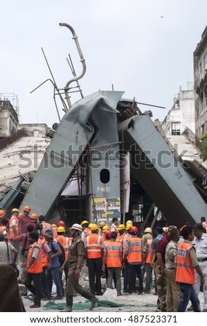 "KOLKATA - APRIL 1: Twisted ""T"" of the main structure during the rescue effort after an under construction flyover collapsed killing 27 people on April 1, 2016 in Kolkata, India."