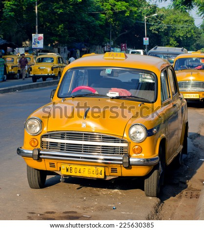 KOLKATA (CALCUTTA),  INDIA - OCTOBER 06: Yellow taxi cabs on October 06, 2014  in Kolkata, India.  - stock photo
