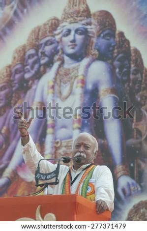 KOLKATA - DECEMBER 20: Agitated Mohan Bhagwat- the chief of Rashtriya Swayamsevak Sangh (RSS) giving speech during the Golden Jubilee celebration of VHP- on December 20, 2014 in Kolkata, India. - stock photo