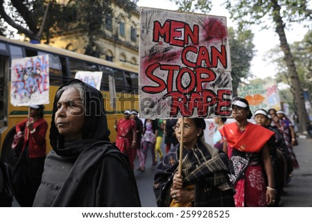 KOLKATA - DECEMBER 16 : Women of all ages with signs during a rally to remember the gang raped victim from New Delhi in the year 2012 - on December 16, 2014 in Kolkata , India. - stock photo