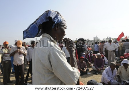 KOLKATA- FEBRUARY 13:  A follower chewing a pouch packet of water during a political rally  in Kolkata, India on February 13, 2011.
