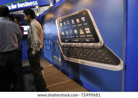 KOLKATA- FEBRUARY 20: A NOKIA E7 model projected to the customers  during the Information and Communication Technology (ICT) conference and exhibition in Kolkata, India on February 20, 2011. - stock photo