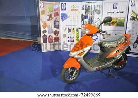 KOLKATA- FEBRUARY 20: A scooter that runs on solar energy on display during the Information and Communication Technology (ICT) conference and exhibition in Kolkata, India on February 20, 2011. - stock photo