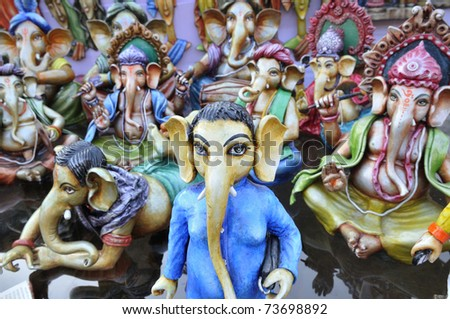 KOLKATA - FEBRUARY 23: A  series of Lord Ganesha sculptures on display during the Asia's biggest Handicraft fair in Kolkata on February 23, 2011 in Kolkata, India.