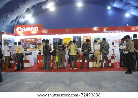 KOLKATA- FEBRUARY 20:  Consumers flocking inside a CANON booth, during the Information and Communication Technology (ICT) conference and exhibition in Kolkata, India on February 20, 2011. - stock photo