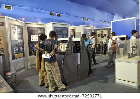 KOLKATA- FEBRUARY 20:  People gathered inside a science museum booth during the Information and Communication Technology (ICT) conference and exhibition on February 20, 2011 in Kolkata, India. - stock photo