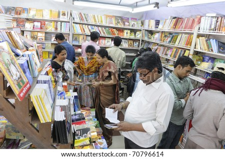 KOLKATA- FEBRUARY 4: People of all ages select books  during the 2011 Kolkata Book fair in Kolkata, India on February 4, 2011. - stock photo