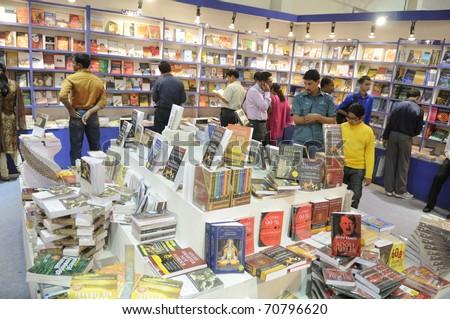 KOLKATA- FEBRUARY 4: Shoppers select books inside a book stall during the 2011 Kolkata Book fair  in Kolkata, India on February 4, 2011. - stock photo