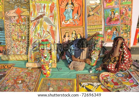 KOLKATA- FEBRUARY 23: Two unidentified woman working on their art  during the Handicraft Fair on February 23, 2011 in Kolkata, India.