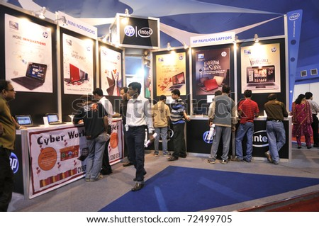 KOLKATA- FEBRUARY 20:  Visitors  inside a HP pavilion to get a hands on ,during the Information and Communication Technology (ICT) conference and exhibition in Kolkata, India on February 20, 2011. - stock photo